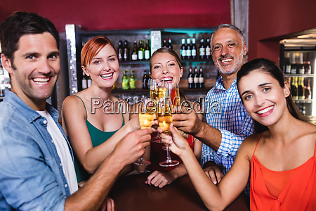 friends toasting champagne glass in nightclub