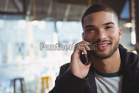 portrait of man talking on phone