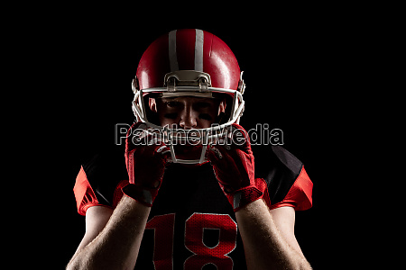 american football player standing with rugby