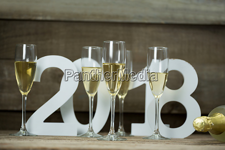 champagne glasses surrounded against numbers forming