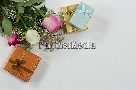 flower bouquet and gift on white