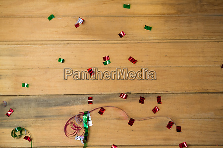 confetti and streamers on wooden surface
