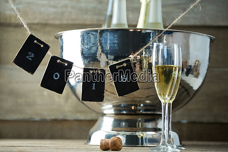 champagne bottles in ice bucket and