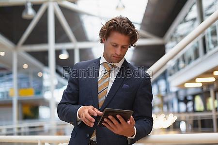 businessman using digital tablet in the