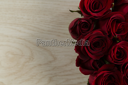 rose flower on wooden table