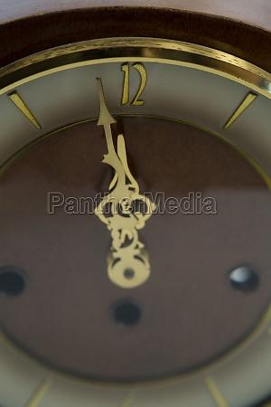 clock hands reaching 12 clock midnight