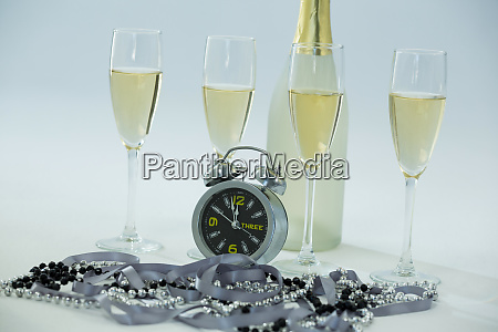 champagne with alarm clock and glass