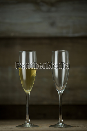 full and empty glass of champagne