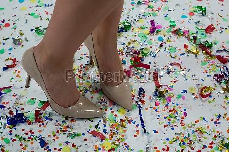 woman standing wearing beige heels standing