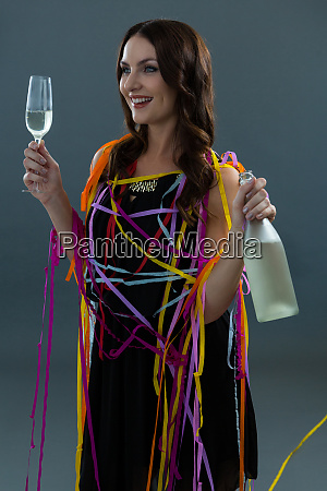 smiling woman wrapped in multi color