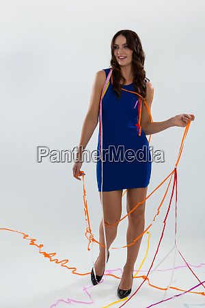 woman wrapped in multi color streamers