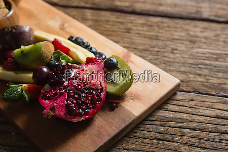 various fruits on chopping board