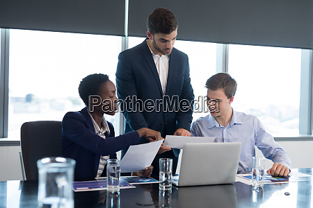 executives discussing over documents