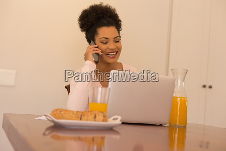 woman talking on mobile phone while
