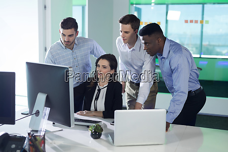 executives discussing over personal computer