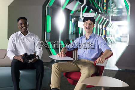 portrait of male executives using virtual