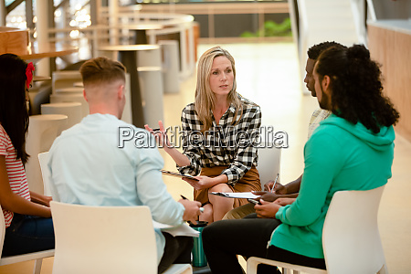 business people sitting together and having