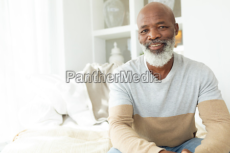 man smiling while sitting inside a