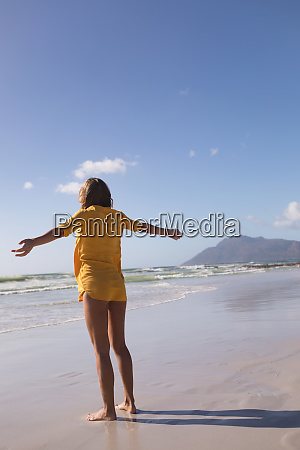 woman standing with arms outstretched at