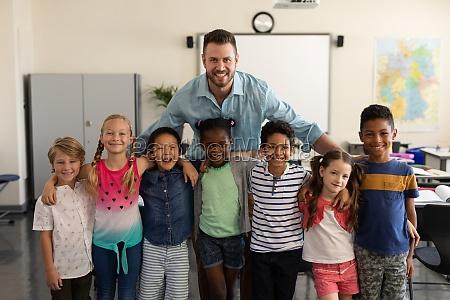 happy school kids and teacher standing