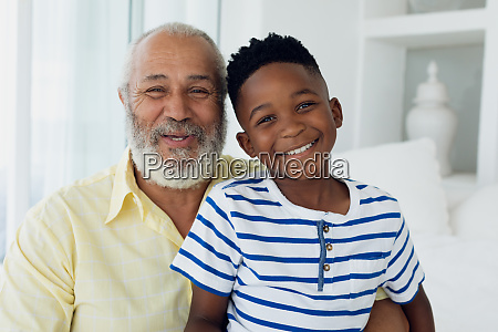 grandfather and grandson smiling