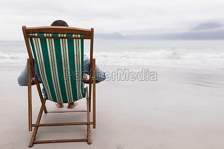 man relaxing on a beach chair