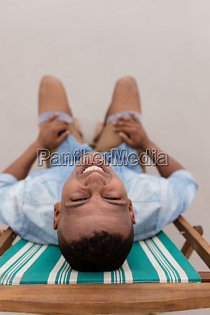 man smiling while relaxing on a