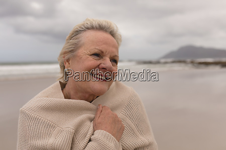 active senior woman wrapped in jumper