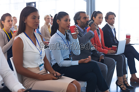 business people attending a business seminar