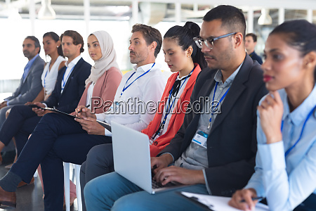 audience listening to speaker in a