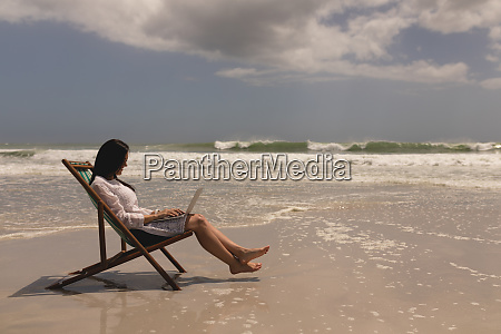 young woman relaxing on sun lounger