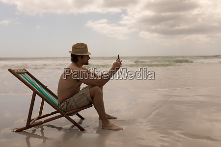 young man with hat relaxing on