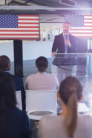 male speaker speaks in a business
