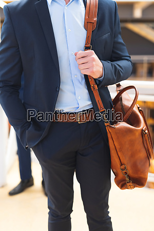 businessman standing with office bag in