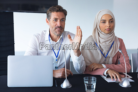 business people sitting together at table