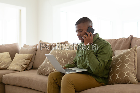 man talking on mobile phone while
