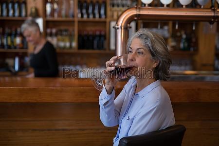 senior woman having glass of red