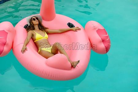 woman in bikini relaxing on a