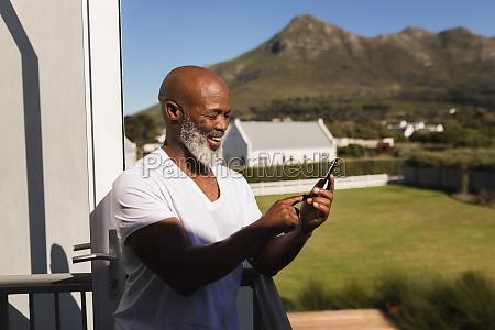 senior man using mobile phone on