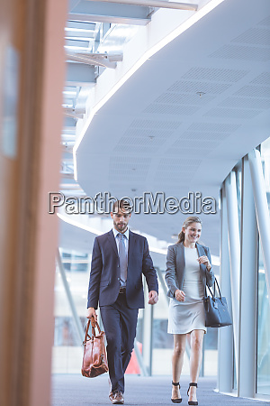 business people walking together in the