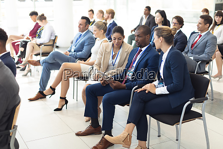 young diverse executives sat in conference
