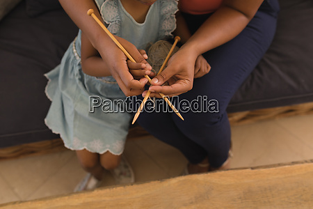 grandmother teaching her granddaughter how to
