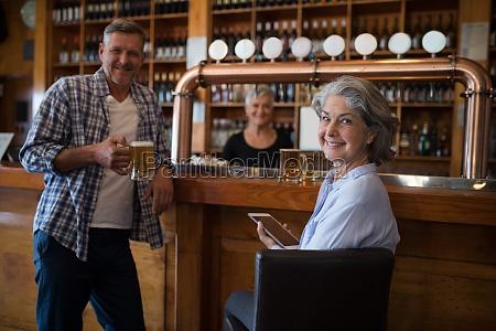 happy man having beer and woman