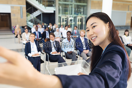 young asian businesswoman doing speech and