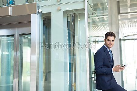 young caucasian businessman looking at camera