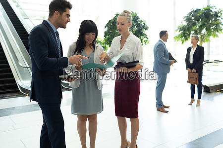 diverse business people interacting with each
