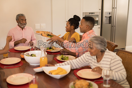 multi generation family having meal together