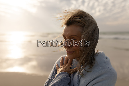 senior woman wrapped in a shawl