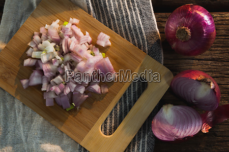 chopped onion on chopping board
