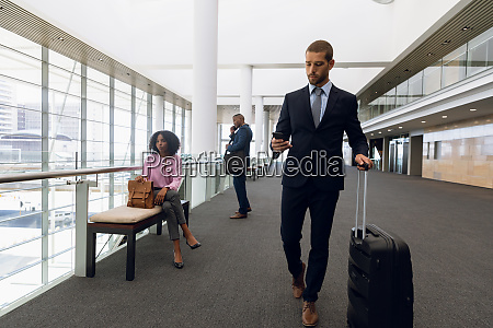 diverse travelling business people in modern